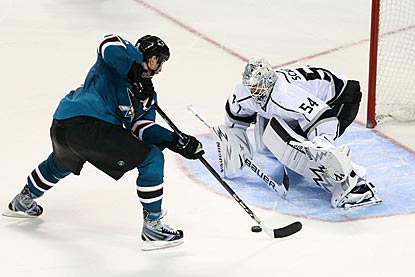 Joe Thornton, who rarely participates in shootouts, moves in on Ben Scrivens and scores the deciding goal.  (USATSI)