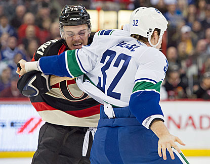 Vancouver's Dale Weise, who scores a goal in the Canucks' 5-2 win, slugs it out with Ottawa's Mark Borowiecki. (USATSI)