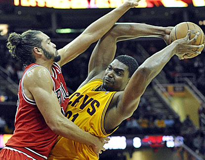 Joakim Noah applies some aggressive defense but it isn't enough as Andrew Bynum scores 20 points for the Cavs. (USATSI)