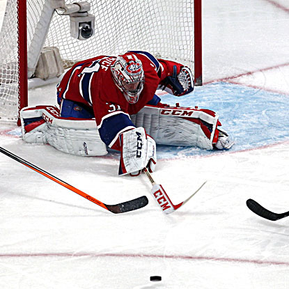Canadiens goalie Carey Price makes one of his 28 saves in the win over the Devils. (USATSI)