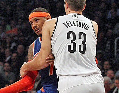 Mirza Teletovic unloads with a hard foul on Carmelo Anthony. Anthony is not deterred, scoring 19 points on just eight shots. (USATSI)