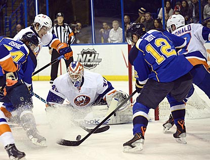 Derek Roy (12) prepares to shoot the puck past Islanders goalie Anders Nilsson during the second period.  (USATSI)