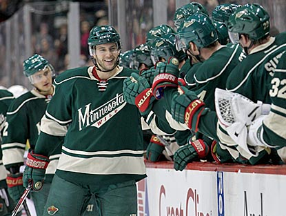 Marco Scandella goes down the welcoming line after putting Minnesota ahead for good with his first goal of the season.  (USATSI)