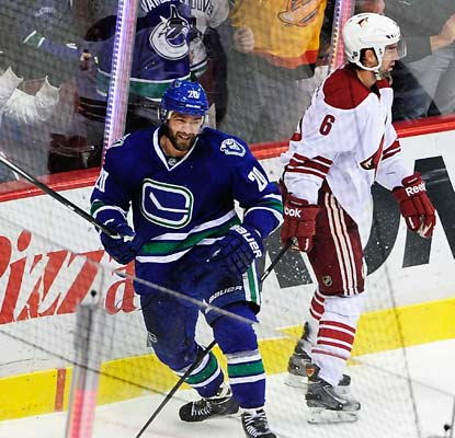 Chris Higgins sends the Vancouver fans home happy with his goal at 3:41 in overtime against the Coyotes.  (USATSI)