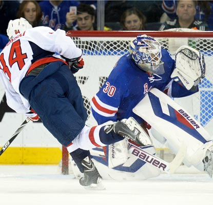 Mikhail Grabovski converts a penalty shot against Henrik Lundqvist late in the second period.  (USATSI)