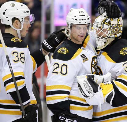 The Bruins celebrate the win over the Maple Leafs with backup goalie Chad Johnson, who records 30 saves.  (USATSI)