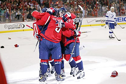 Alex Ovechkin celebrates with teammates in the second period after scoring his third goal of the game.  (USATSI)