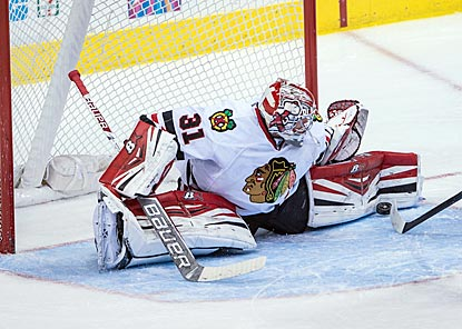 Chicago's Antti Raanta goes all out to thwart Dallas' Erik Cole (not pictured) during the third period.  (USATSI)