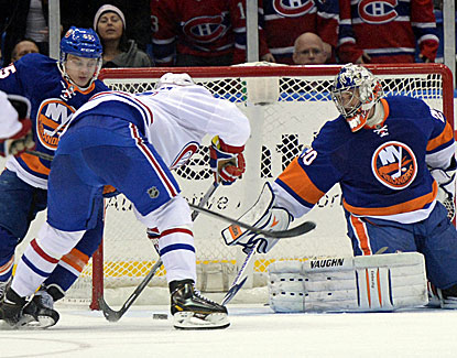 Canadiens left wing Max Pacioretty comes through in OT, scoring the winner against Isles goalie Evgeni Nabokov. (USATSI)