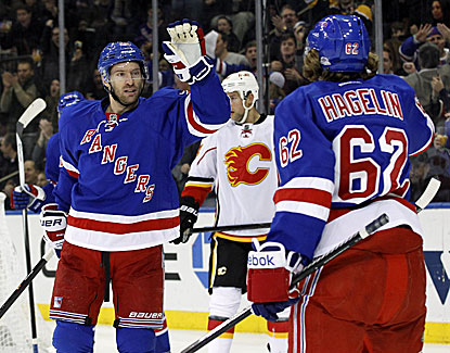 Carl Hagelin scores in the second period to help the Rangers erase an early two-goal deficit. (USATSI)