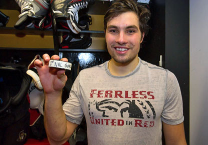 Cody Ceci holds the puck used to score the winning goal -- the first of his career -- in overtime. (USATSI)