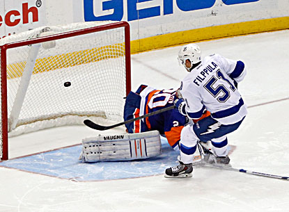 Valtteri Filppula scores on Islanders goalie Evgeni Nabokov during the shootout. (USATSI)