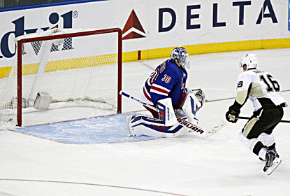 Brandon Sutter (right) beats goalie Henrik Lundqvist for the winning goal during a shootout against the Rangers. (USATSI)