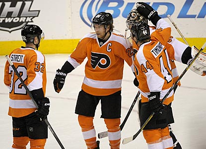 The Flyers celebrate their victory, in which Claude Giroux (center) scores the tying and winning goals in the final 3:46.  (USATSI)