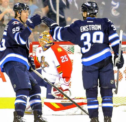 Toby Enstrom gets on the scoreboard and the Jets earn their first win in Winnipeg since Nov. 15.  (USATSI)