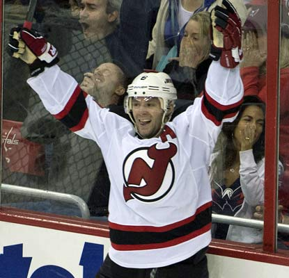 The Devils' Andy Greene finishes off the Capitals 43 seconds into overtime. He also has two assists.  (USATSI)