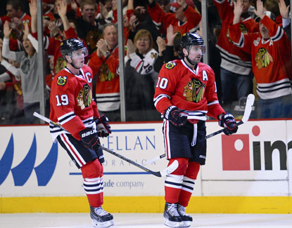 Chicago fans celebrate after Patrick Sharp (right) scores his second goal against the Devils during the third period. (USATSI)