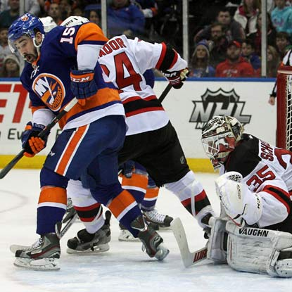 Cory Schneider stops 30 shots and holds off a late Islanders' charge to earn the win for New Jersey.  (USATSI)