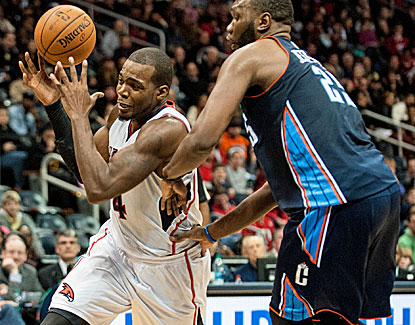 Paul Millsap scores a season-high 31 points for the Hawks who overcome a strong showing from Al Jefferson. (USATSI)