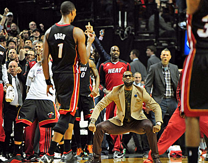 LeBron James and the Miami bench celebrate Chris Bosh's long 3-pointer, which wins the game for the Heat. (USATSI)