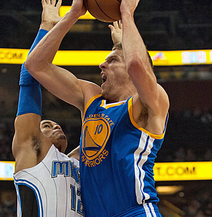 Golden State's David Lee scores 22 points in just 28 minutes against the Magic. He also grabs nine rebounds. (USATSI)