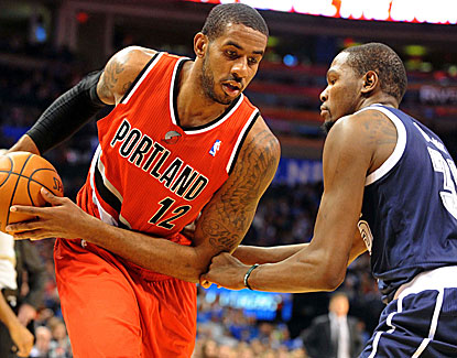 LaMarcus Aldridge works against Thunder star Kevin Durant. Aldridge scores 25 points to go with 14 rebounds. (USATSI)