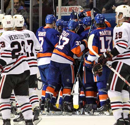 The Islanders revel in their overtime win over the Blackhawks following Kyle Okposo's decisive score.  (USATSI)