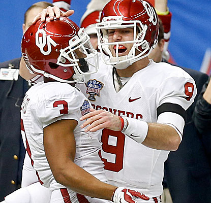 Trevor Knight celebrates a touchdown with wide receiver Sterling Shepard. Knight passes for 348 yards and four touchdowns. (USATSI)