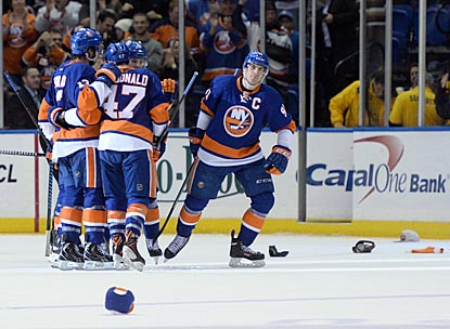 Islanders captain John Tavares is the man of the hour after completing a hat trick in the third period.  (USATSI)