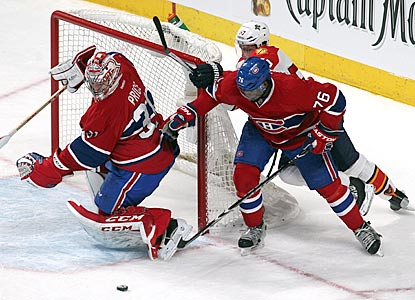 P.K. Subban (76) helps out Canadiens goalie Carey Price by clearing a loose puck during the third period.  (USATSI)