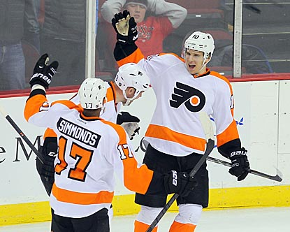 Philadelphia's Wayne Simmonds (17) is the first to congratulate Brayden Schenn on his overtime goal.  (USATSI)