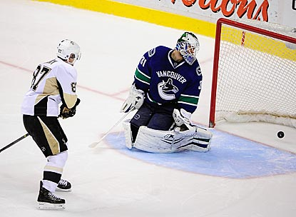 Sidney Crosby scores against Vancouver's Eddie Lack for the only goal of the shootout round.  (USATSI)