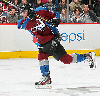Tyson Barrie scores the game-winning goal 33 seconds into overtime, completing Colorado's rally. (USATSI)
