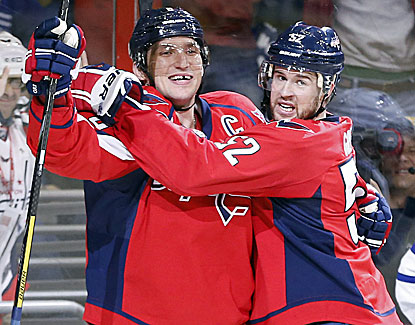 Alex Ovechkin, left, scores a goal and adds an assist in Washington's 3-2 win over Toronto. (USATSI)