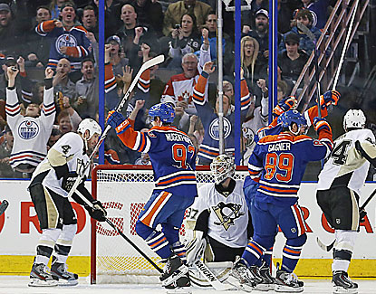 Ryan Nugent-Hopkins scores in the third period and adds the winner in OT as the Oilers edge the Pens. (USATSI)