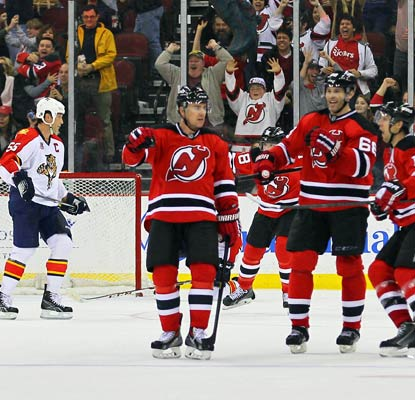 The Devils avoid a shootout after Marek Zidlicky's dramatic score with just 2.1 seconds left in overtime.  (USATSI)