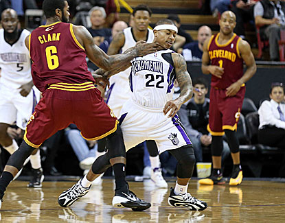 Earl Clark and the Cavaliers rough up Sacramento's Isaiah Thomas but can't stop him from scoring 26 points. (USATSI)