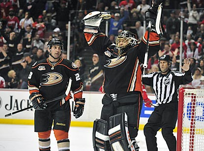 Jonas Hiller celebrates his shutout and 14th consecutive victory, which is three shy of the NHL record.  (USATSI)