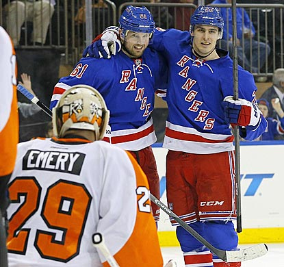 Rick Nash (left) and Chris Kreider each score against Ray Emery to continue the Rangers' ascent in the Metropolitan Division.  (USATSI)