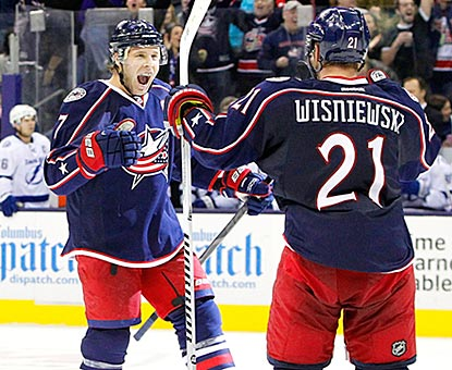 Jack Johnson celebrates with James Wisniewski after Columbus takes the lead for good late in regulation.  (USATSI)