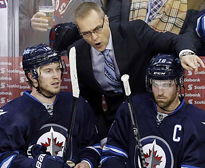 New Jets coach Paul Maurice, who previously coached Hartford, Carolina and Toronto, confers with Bryan Little and Andrew Ladd.  (USATSI)