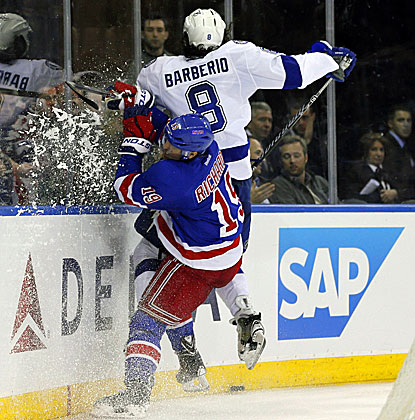 The Rangers' Brad Richards checks Lightning defenseman Mark Barberio into the boards during the second period. (USATSI)