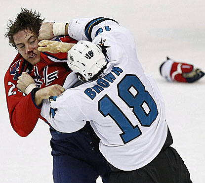 San Jose's Mike Brown drops the gloves with Washington's Aaron Volpatti in the first period.  (USATSI)