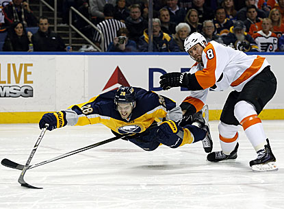 Flyers defenseman Nicklas Grossmann trips Sabres center Zemgus Girgensons in the second period. (USATSI)