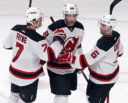 Jaromir Jagr (center) celebrates his latest milestone with Devils teammates Mark Fayne (left) and Andy Greene.  (USATSI)