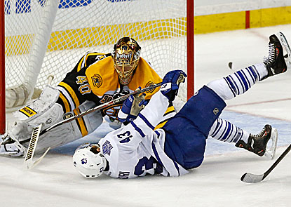 Bruins goalie Tuukka Rask saves a shot by Maple Leafs center Nazem Kadri, who falls down.  (USATSI)