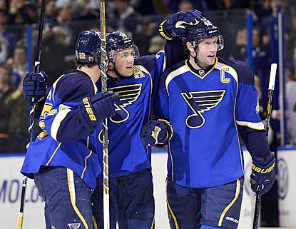 T.J. Oshie (center) celebrates his fifth career two-goal game, which helps the Blues bounce back after a loss in Vancouver.  (USATSI)