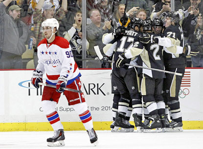 Capitals center Marcus Johansson skates away as the Penguins celebrate Olli Maatta's third-period goal.  (USATSI)