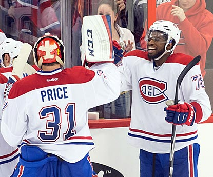 P.K. Subban (right) gets a high five from winning goaltender Carey Price after Subban scores in overtime.  (USATSI)