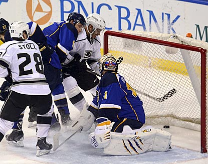LA's Dwight King gets a close-up look at one of Trevor Lewis' two third-period goals getting past Jaroslav Halak.  (USATSI)